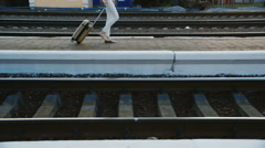 A woman in a business suit in a travel bag is on the railway station. In the Stock Footage