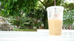 Ice coffee put on the table in the garden Stock Footage