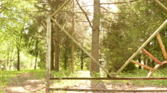Fence of the kids abandoned camping. Smooth and slow steady cam shot. - stock footage