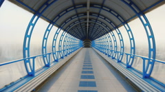 Camera flying through a glass tunnel. The transition between the terminals of Stock Footage