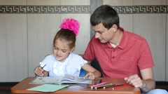Daughter and dad leaf textbook, choosing a job to be executed Stock Footage