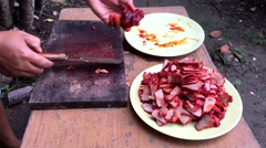 Cutting honey pork with a knife on a wood board. Stock Footage