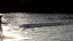 The Wakeboarder Rides on the Water in Slow Motion. Stock Footage
