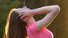A Young Girl in Slow Motion Shake Her Head and Playing With Hair. the Action Stock Footage