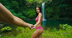 Woman Leading Man to Waterfall Stock Footage
