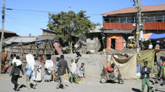 Pilgrims and local people on Main Street in Lalibela, Ethiopia. Stock Footage