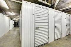 White storage units in the basement for apartment building Stock Photos