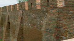 Tall wall at the side of a city Stock Footage