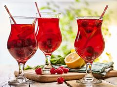 On wooden is ice cold beverage glass with berries cocktail . - stock photo