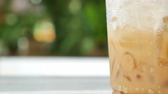 Water drops on the plastic glass of iced coffee Stock Footage