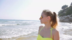 Summer vacation woman having fun on beach walking relaxing in the sun wearing Stock Footage