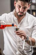 Bartender make a cocktail - stock photo