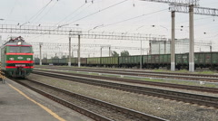 Electric train traveling on railway tracks - stock footage