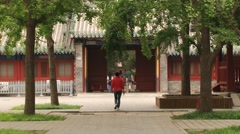 People enter to the temple of Confucius in Beijing, China. Stock Footage