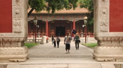 People walk in the temple of Confucius in Beijing, China. Stock Footage
