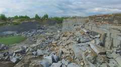 Flying over a stone quarry Stock Footage