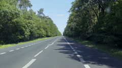 Driving on a long straight road Stock Footage