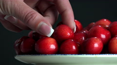 Fresh, ripe, juicy cherries rotate. Red cherry plate rotation on dark backgro Stock Footage