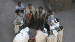 Pilgrims singing and dancing in front of the church of St. George in Lalibela Stock Footage