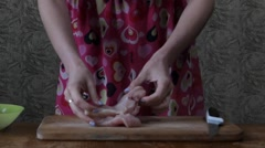 Girl in the Kitchen Cut Meat For Chops. Stock Footage