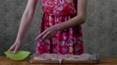 Girl in the Kitchen Beating Eggs With a Fork in a Bowl. Stock Footage