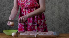 Girl in the Kitchen With a Knife Breaks the Eggs. Stock Footage