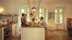 Four Friends Cooking Together in Large Open Plan Kitchen Stock Footage