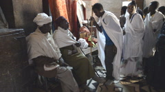 Pilgrims praying in the St. George's church in Ehtiopia Stock Footage