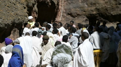 Pilgrims in front of the church of St. George in Lalibela, Ethiopia Stock Footage
