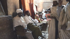Pilgrims praying in the church of St. George in Ethiopia Stock Footage
