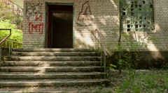 An abandoned house. Smooth and slow steady cam shot. Clean and bright daytime. - stock footage