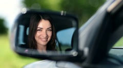 Reflection of pretty woman in car side-view mirror - stock footage