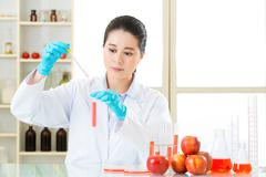 Scientist use dropper to test  genetic modification food Stock Photos