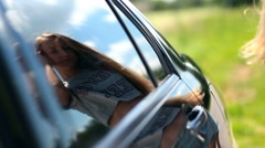 Reflection of cute woman in car side window Stock Footage