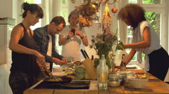 Four Friends Cooking Together Stock Footage