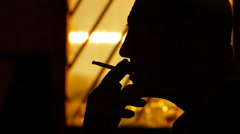 Silhouette of male smokers - stock footage
