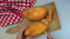 Man slicing tasty cantaloupe melon on table, top view Stock Footage
