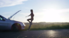 4K Funny clip of blurred man kicking his car in frustration, blurred for text - stock footage