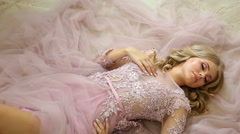 young sexy blonde girl in Lacy pink dress - stock footage