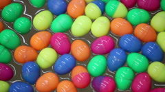 Colorful of lucky balls or eggs floated in water for gamble - stock footage