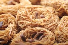 Fresh delicious arabic sweets, kanafeh, close-up shot Stock Photos