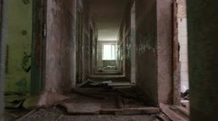 Running in the corridor in the abandoned house. Smooth and slow steady cam shot. - stock footage