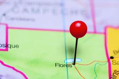 Flores pinned on a map of Guatemala - stock photo