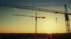 Aerial Drone Shot of Construction Cranes in Sunset Light Stock Footage