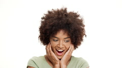 Surprised young beautiful african girl laughing over white background. Slow Stock Footage