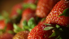 Macro shot of refocusing on juicy strawberryes Stock Footage