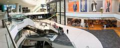 Panoramic View Of People Crowd Rush In Shopping Luxury Mall Interior Stock Photos