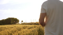 Young man controling drone in field at sunset. Slow motion Close up Stock Footage