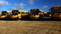 4K UltraHD A Motion controlled timelapse pan of line of schoolbuses Stock Footage