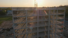 Aerial Drone Shot of Construction Site of Modern Glass Office Building in City - stock footage